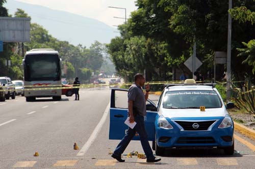 Ejecutan a taxistas-Oaxaca.